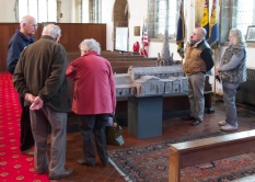 Visitors with one of the Woolly Spires sculptures
